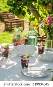 Preparations for dinner served in the garden in summer
