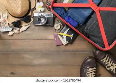 prepare accessories and travel items with  baggage on wooden board, flat lay, top view background