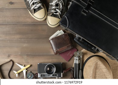 Prepare accessories for travel, Old black vintage suitcase with welcome text on vintage tone, copy space and travel concept