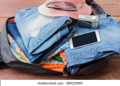 Prepare a bag of clothes and accessories for the holidays.