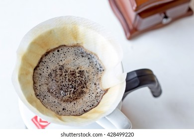 Prepare to brew the coarseness coffee  filled in the paper filter with warm water 200 degrees Fahrenheit. Brew coffee