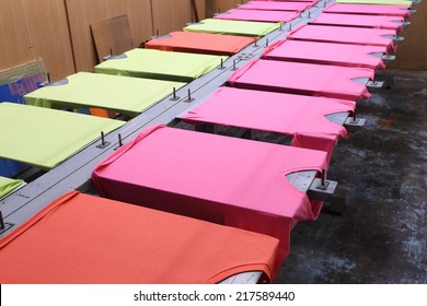 prepare colorful t-shirt on screen table