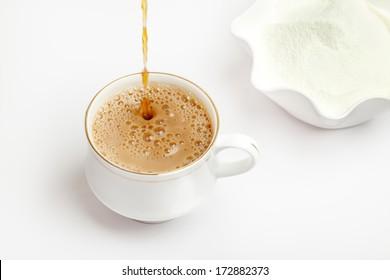 Prepare cup of tea with dairy milk powder