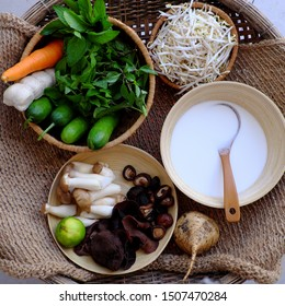 Prepare raw material from vegetable for Vietnamese homemade vegan food, vegetarian steamed rice pancake or banh cuon from rice flour, mushroom, carrot, sausage, herb, cucumber