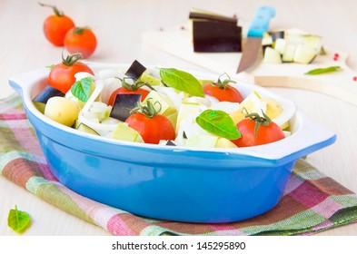 Prepared for baked vegetables: potato, zucchini, eggplant, tomato, tasty vegetarian dish for dinner