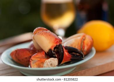Prepared crab legs served with beer