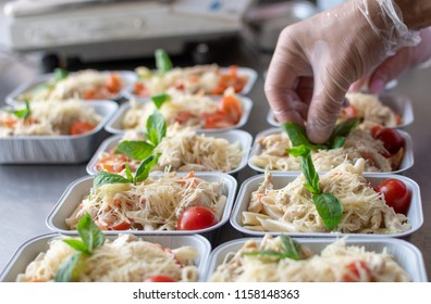prepared diet Lunches in lunch boxes: chicken salad, parmesan, pasta and cherry tomatoes with Basil, the concept of take-away and food delivery