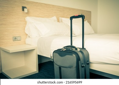 Prepared fresh bed, scene in hotel room. Horizontal retro toned shot