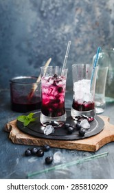Prepared Fresh blueberry drink with ice cubes in glasses.