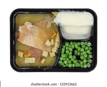 A prepared frozen meal in a black, plastic tray.