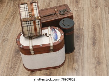 Prepared Luggage and Suitcases for holiday at home in diagonal