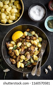 Prepared mushrooms and gnocchi dish with spices in the pan,selective focus