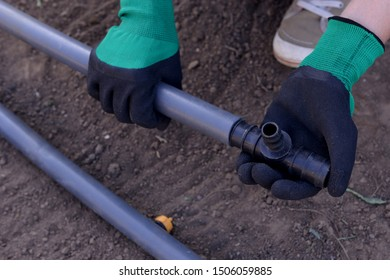 Prepared for planting in early Spring. faucet with handle for drip irrigation. Drip Irrigation System Close Up. DIY drip irrigation system assembly