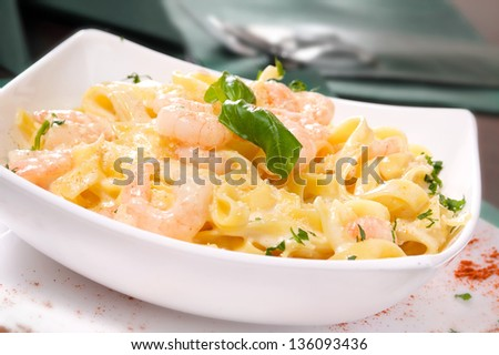 47dfc900ca5d Prepared Shrimp with linguine noodles and creamy garlic sauce on top green  basil spring. Selective
