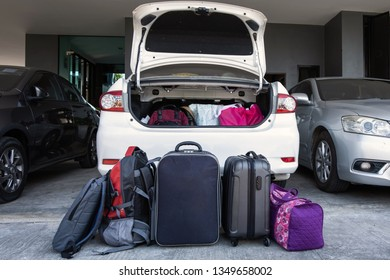 Prepared suitcases and bags before loading to trucnk of car. Travel concept.