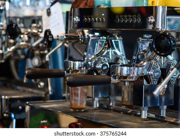 prepares coffee in his coffee shop; close-up