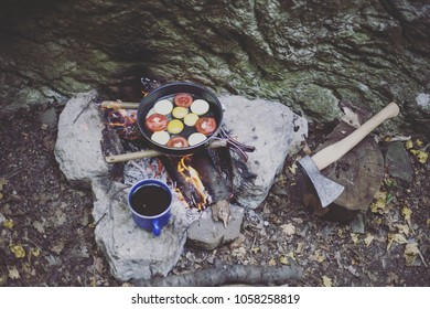 Preparing breakfast in the camping in the mountains.