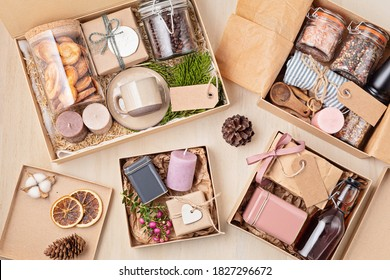 Preparing care package, seasonal gift box with coffee, cookies, spices and cups. Personalized eco friendly basket for family and friends for thankgiving, christmas, mothers and fathers day holidays - Shutterstock ID 1827296672