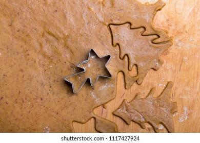 Preparing Christmas gingerbread cookies. Gingerbread dough and  cookies ingredients. Christmas tree shape.