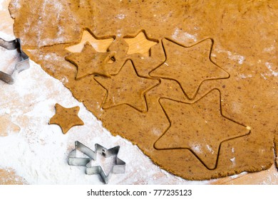Preparing Christmas gingerbread cookies. Gingerbread dough and star shape cookies ingredients.
