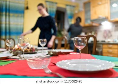 Preparing a Christmas table before Christmas eve.