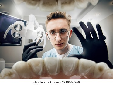 Preparing. Doctor looking into mouth, checking, examining teeth. Using professional tools and equipments. Healthcare and medicine, stomatology, feelings of patient. Look from inside the teeth.
