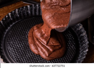 Preparing dough for chocolate pie. Process Of Making Cake.