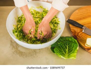 Preparing fermented preserved vegetables. Cabbage kimchi and sauerkraut sour cabbage.