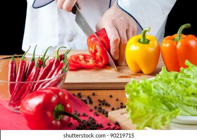 Preparing food: chef cutting a red bell pepper