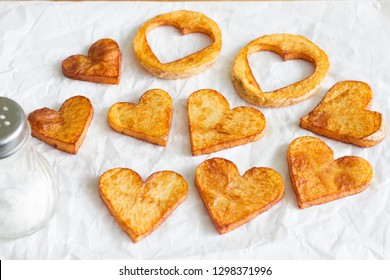 Preparing a food for Valentine's Day abstract love concept witch french fries chips heart shape