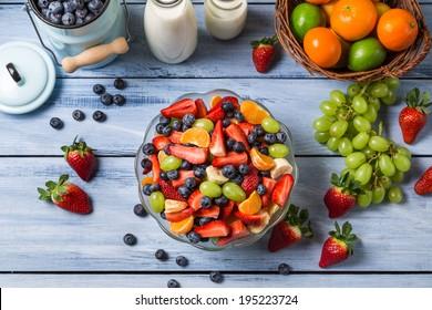 Preparing a healthy spring fruit salad