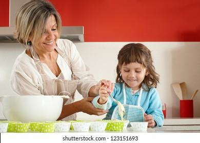 Preparing homemade muffins and cupcakes
