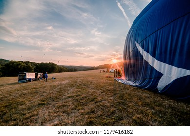 Preparing of hot air balloon at the balloon festival in Bouzov at the sunset.