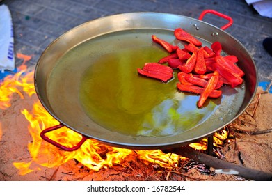 preparing a huge paella - spanish traditional food
