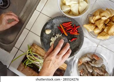Preparing ingredient to cook spicy stir fried shrimp tofu