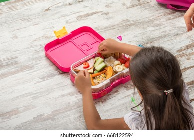 preparing lunch for child school top view on white background