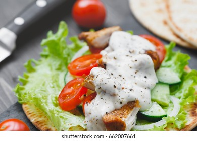 Preparing mexican fajita wrap with chicken meat and vegetables