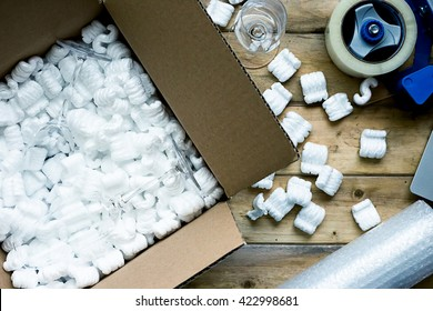 Preparing for moving. Packing, selling online, shipping, moving and lifestyle concept