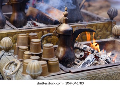 Preparing Oriental coffee in dallah, a traditional Arabic coffee pot