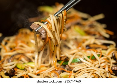 Preparing pad thai at a street hawker mobile restaurant in Bangkok, Thailand. Fried noodle. Shallow dof.