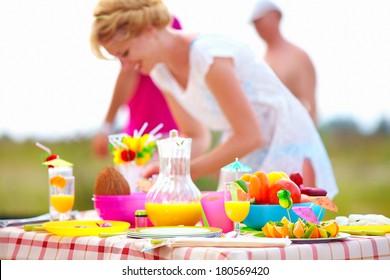 preparing picnic table in summer park
