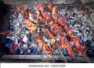 Preparing pork shashlik on the charcoal mangal. Pork grill, Pork shashlik. Marinated shashlik preparing on a barbecue grill over charcoal