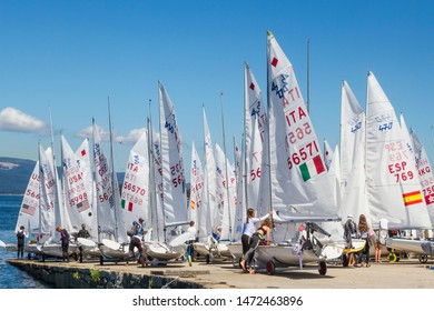 Preparing the sailboats on Vilagarcia de Arousa harbor ramp to the 2019 european junior championship