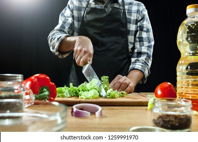 Preparing salad. Female chef cutting fresh vegetables. Cooking process. Selective focus. The healthy food, kitchen, salad, diet, cuisine, organic concept