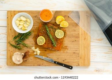 Preparing salmon for sous vide dinner with rosemary garlic, lemon and gochujang infused seasalt
