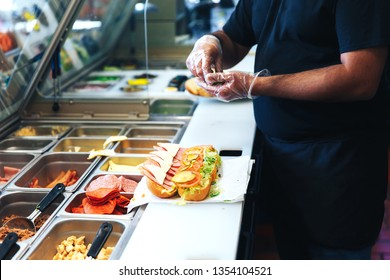 preparing sandwich in the restaurant. the kitchen of fast food restaurant