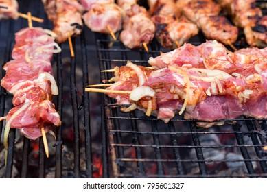 Preparing shashlik on mangal or grill
