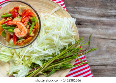 Preparing of spicy papaya salad or Som tum Thai on flat lay copy space