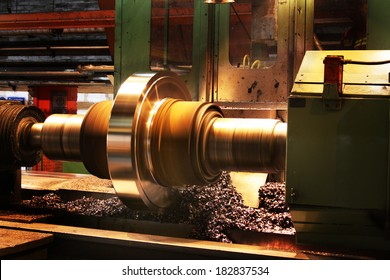 Preparing steel roll on large lathe for reuse in the rolling mill.