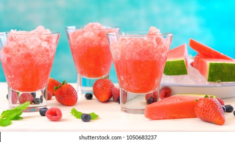 Preparing Summertime refreshing Watermelon granita desserts on a blue and white background.